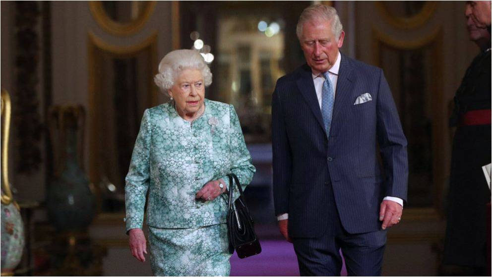 Queen Elizabeth II and the Prince of Wales arrive for the formal opening of the Commonwealth Heads of Government Meeting PA