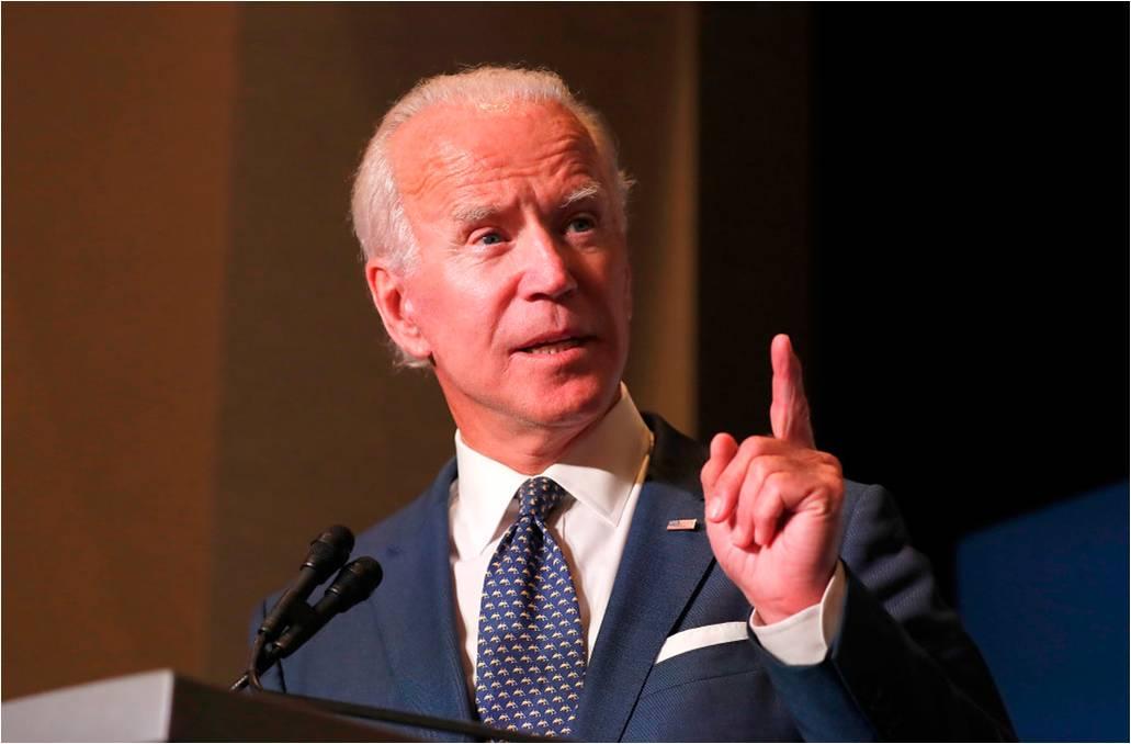 Joe Biden: 'We're walking down a dark path' under Trump – video
