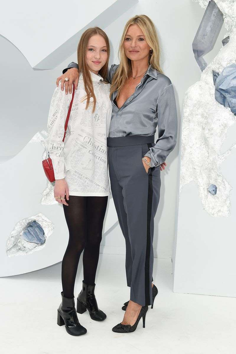 Kate Moss and her lookalike daughter, Lila, sit front row at Dior