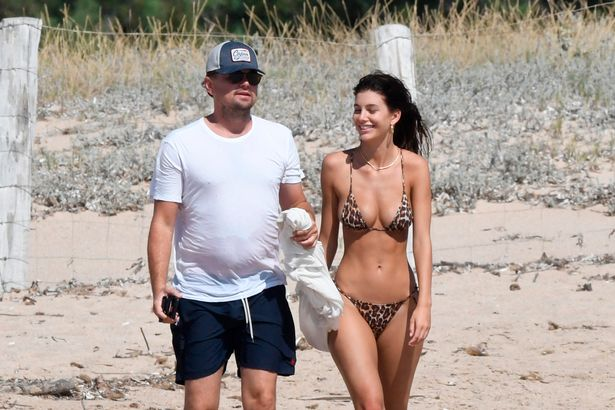 Leonardo DiCaprio strolls along sand with Camila Morrone as couple set to wed
